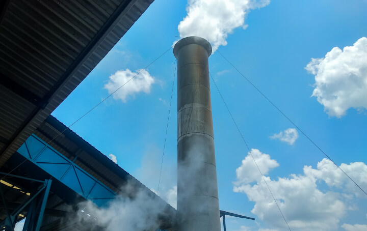 Steam coming out of a building's steam plant.